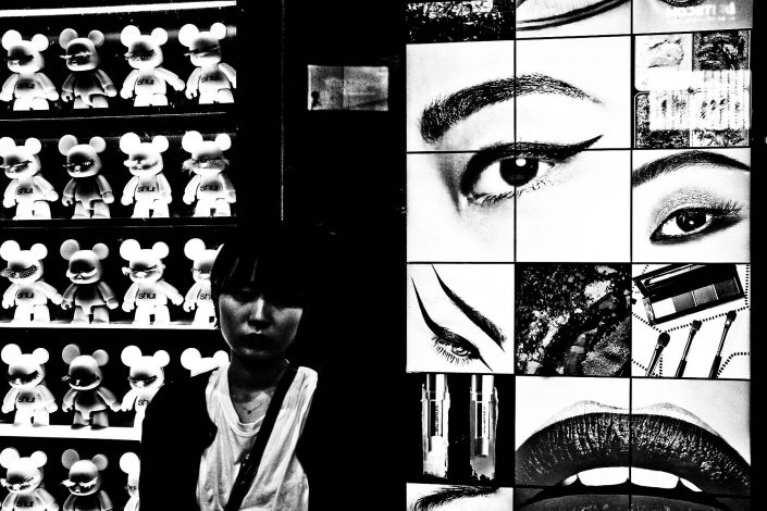 Daido Moriyama like lips photo, commercial with cute dolls and a Japanese lady at Shibuya.