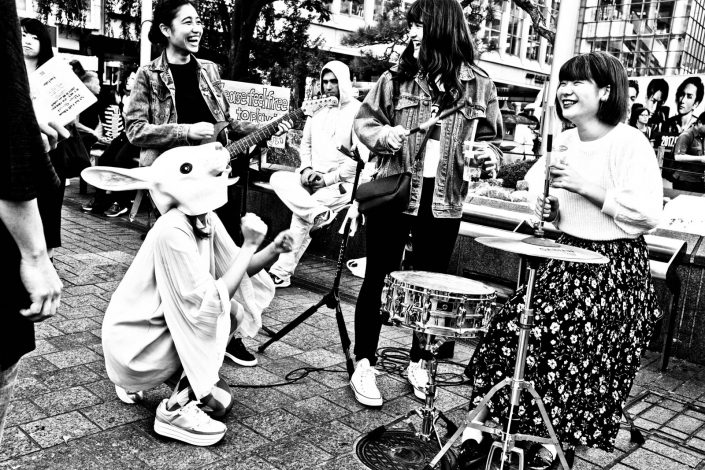 Happy Shibuya rockband with drums,gituar, smiles and a rabbit. Street Photography by Victor Borst
