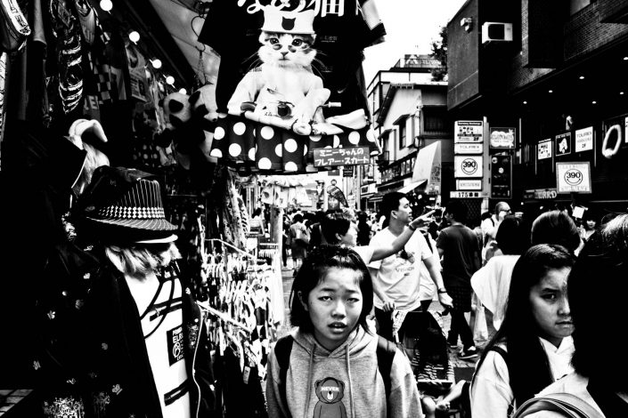 Japanese girl in Harajuku, Tokyo, including a cat t-shirt. Street Photography by Victor Borst