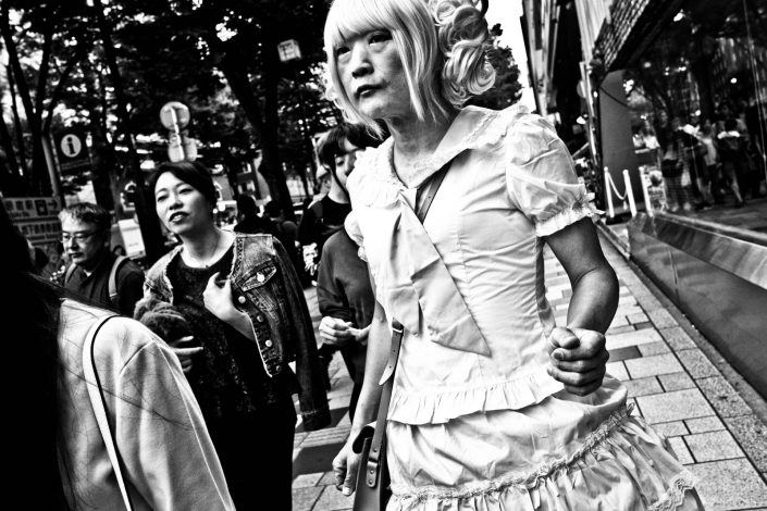 Old Japanese crossdresser Lolita with a dress and wig at Harajuku. Street Photography by Victor Borst