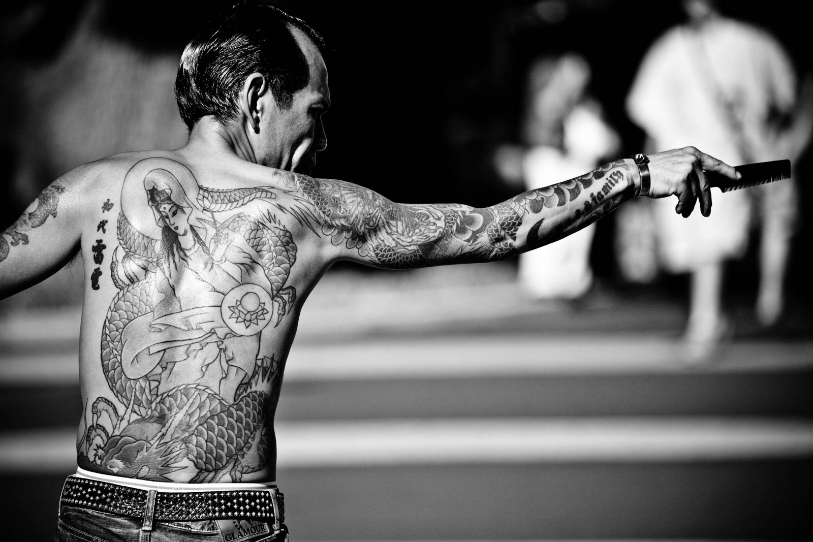 Rock-a-Billy at YoYogi Park, Tokyo, full with tattoos dancing. Street Photography by Victor Borst