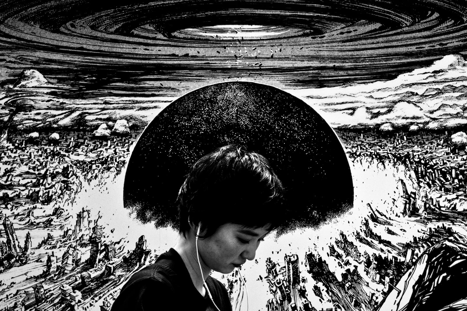 Japanese girl in front of explosion from the anime Akira. Street Photography by Victor Borst
