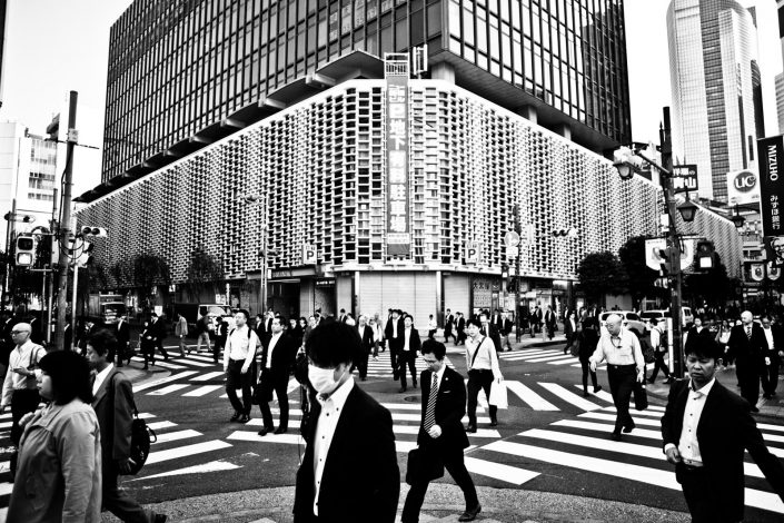 Salarymen walking to work at Shimbashi like zombies. Street Photography by Victor Borst