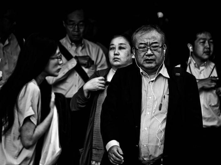 Group of salarymen and women at Shimbashi station, Tokyo. Street Photography by Victor Borst
