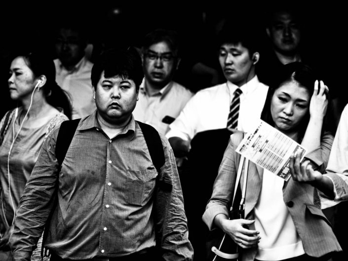 Shimbashi Tokyo Station crowd heading to work, not so happy. Street Photography by Victor Borst