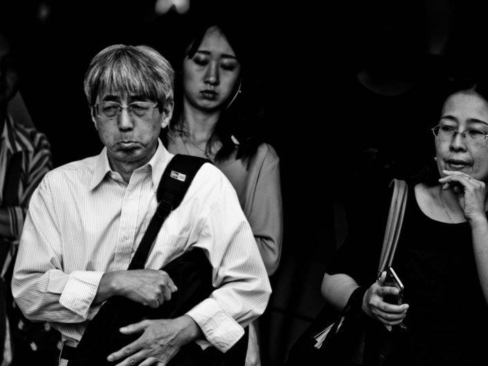 Strange lip portrait of a Japanese man. Shimbashi station morning. Street Photography by Victor Borst