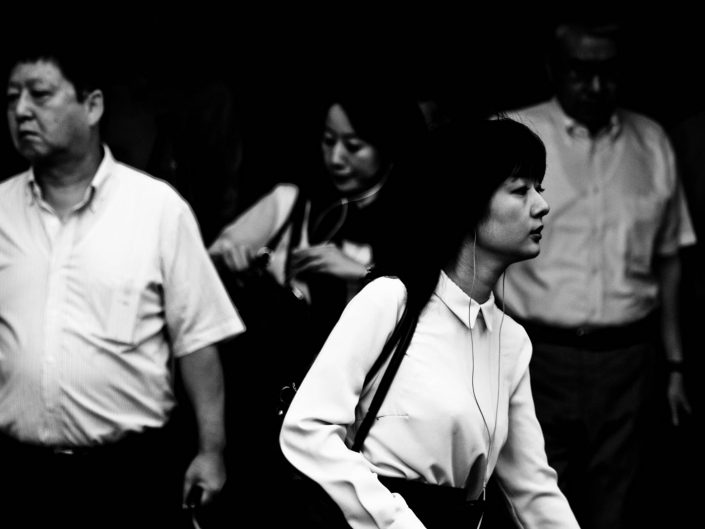 Shimbashi Blues in the morning with a woman not looking in the camera. Street Photography by Victor Borst