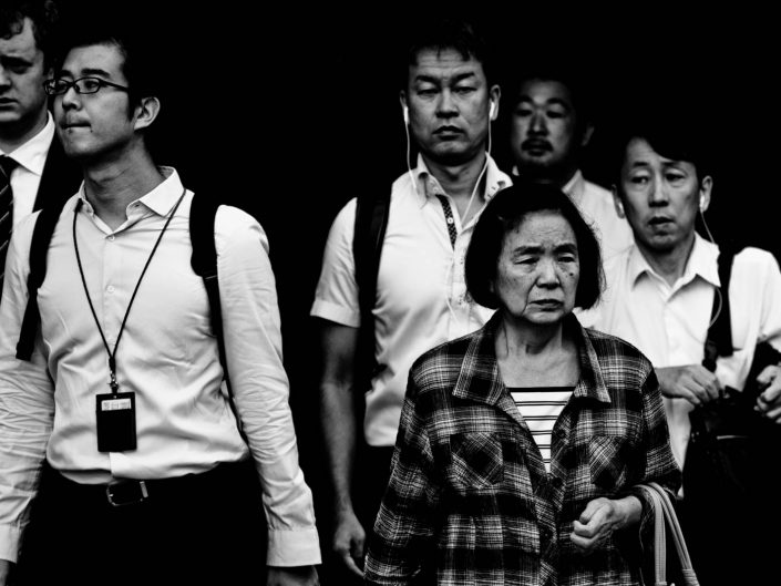 Shimbashi faces during rush hour heading for work. Street Photography by Victor Borst