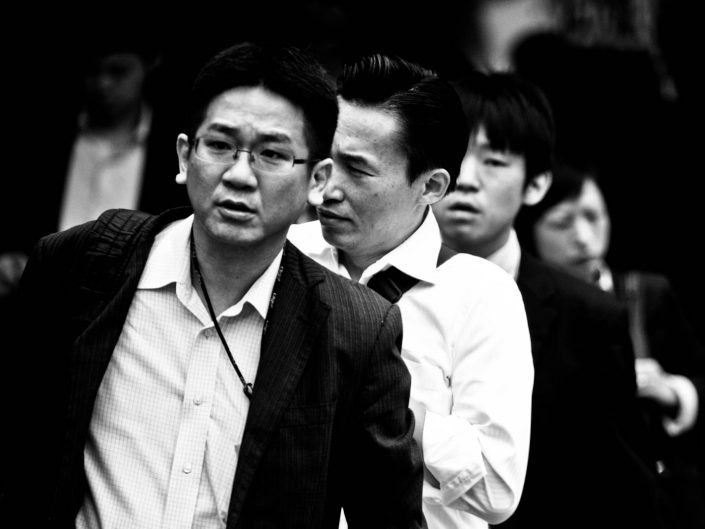 Four faces in a row at Shimbashi station. Street Photography by Victor Borst