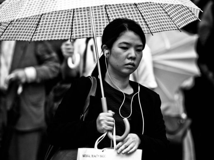 Portrait of a Japanese women with umbrella at shimbashi station. Street Photography by Victor Borst