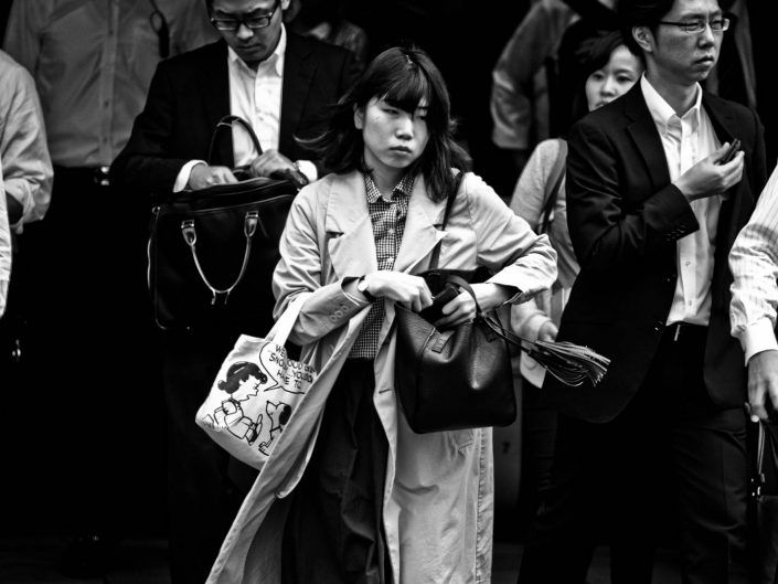 Salarywomen with snoopy bag heading to work at Shimbashi Station. Street Photography by Victor Borst