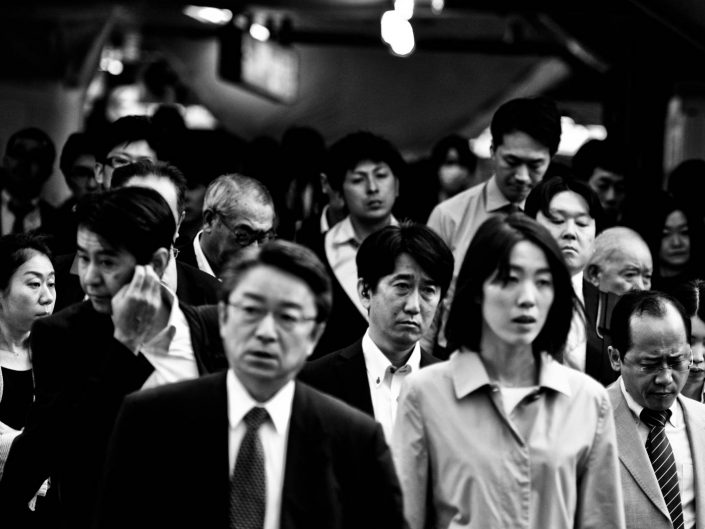 Group of Salararymen and women exiting Shimbashi Station, Tokyo. Street Photography by Victor Borst