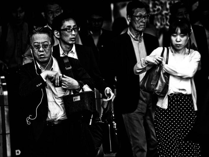 Four Salarymen and women at Shimbashi Station. Street Photography by Victor Borst