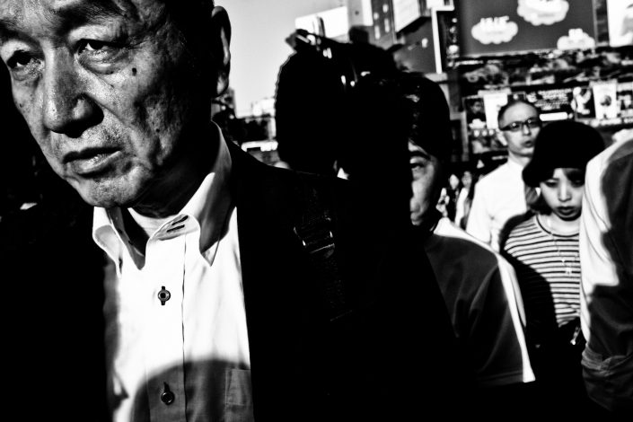 Close up portrait from a man in Tokyo, Shibuya. Street Photography by Victor Borst