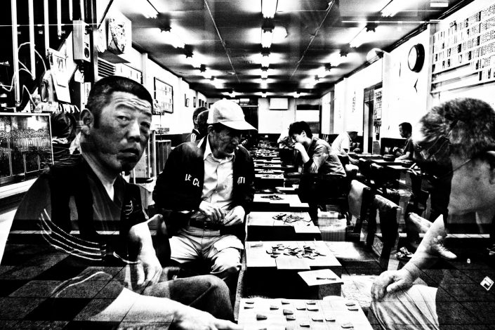Japanese people playing the game Go in Osaka, Japanese chess. Street Photography by Victor Borst