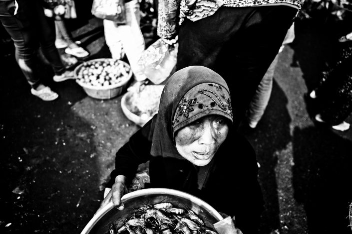 Woman at a market selling fish in Phnom Penh, Cambodia